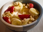 Greek yogurt with bananas, strawberries, and oat cereal